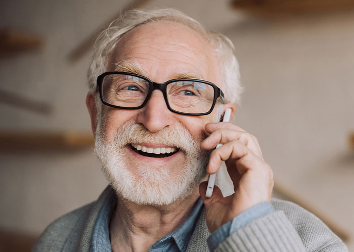 Older adult smiling on the phone