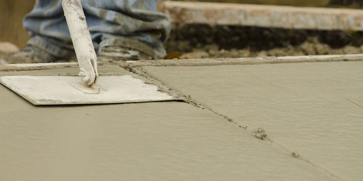 Edger working to smooth concrete